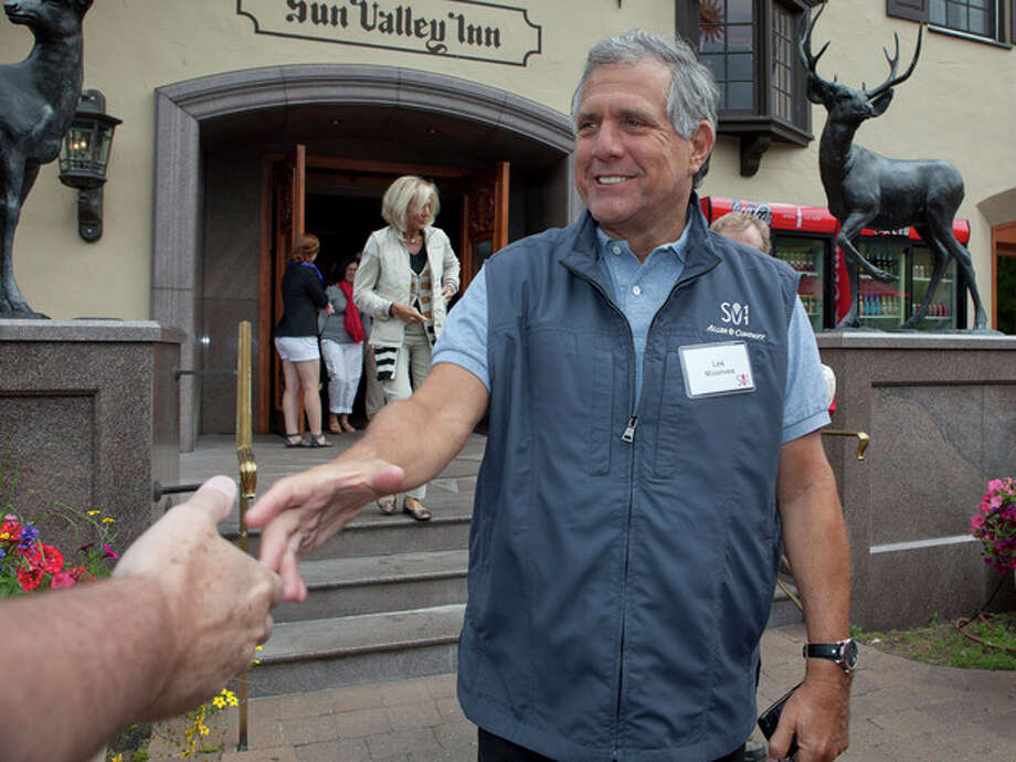 FILE - In this Thursday, July 7, 2011 file photo, Les Moonves, president and CEO of CBS Corporation, greets a member of the media at the Sun Valley Inn for the 2011 Allen and Co. Sun Valley Conference in Sun Valley, Idaho. Moonves is one of the top 10 highest paid CEOs at publicly held companies in America last year, according to calculations by Equilar, an executive compensation data firm, and The Associated Press. The Associated Press formula calculates an executive's total compensation during the last fiscal year by adding salary, bonuses, perks, above-market interest the company pays on deferred compensation and the estimated value of stock and stock options awarded during the year. (AP Photo/Julie Jacobson, File) / AP2011
