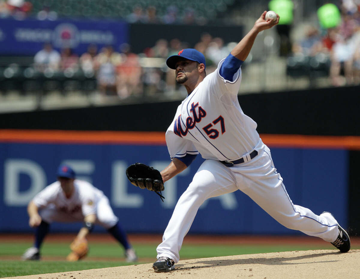 New York Mets' Johan Santana (57) delivers a pitch during the first inning of a baseball game against the San Diego Padres Saturday, May 26, 2012, in New York. (AP Photo/Frank Franklin II)
