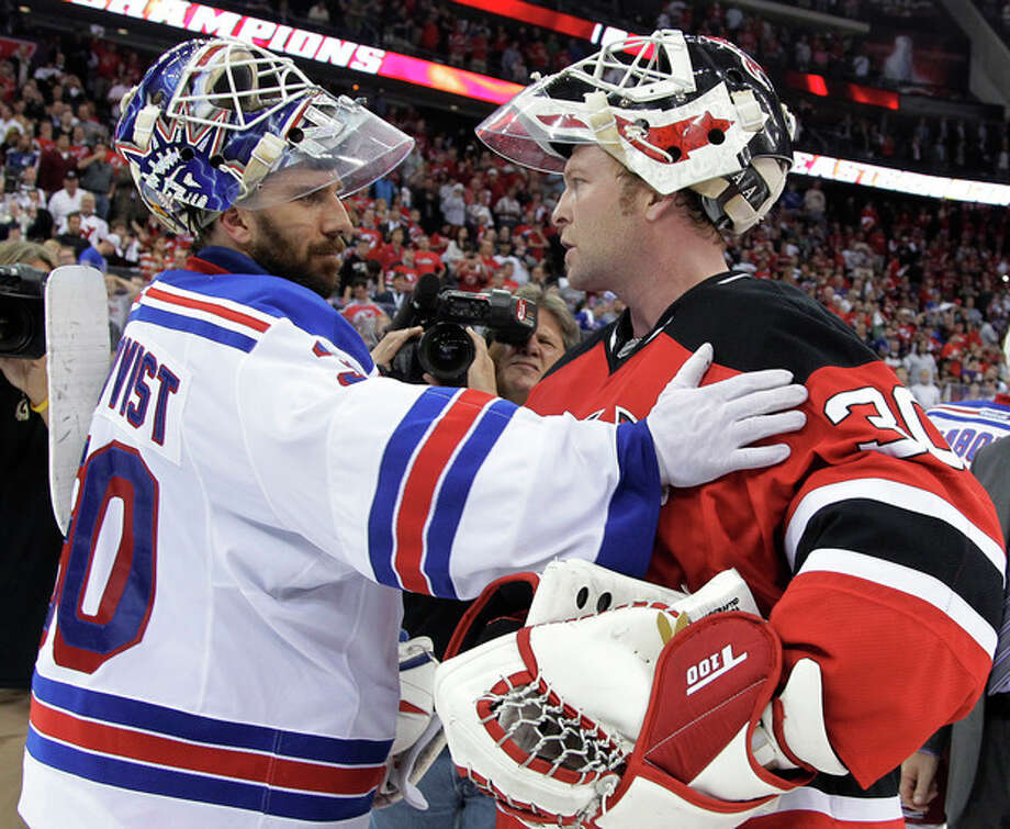New Jersey Devils goalie Martin Brodeur, right, and New York Rangers goalie Henrik Lundqvist, of Sweden, talk after Game 6 of the NHL hockey Stanley Cup Eastern Conference finals, Friday, May 25, 2012, in Newark, N.J. The Devils won 3-2, and advanced to the Stanley Cup finals. (AP Photo/Julio Cortez) / Copyright 2012 The Associated Press. All rights reserved. This material may not be published, broadcast, rewritten or redistributed.