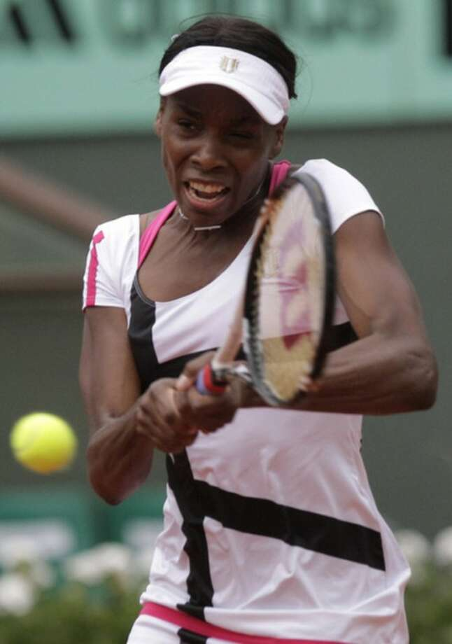 USA's Venus Williams returns the ball to Poland's Agnieszka Radwanska during their second round match in the French Open tennis tournament at the Roland Garros stadium in Paris, Wednesday, May 30, 2012. (AP Photo/Michel Spingler)