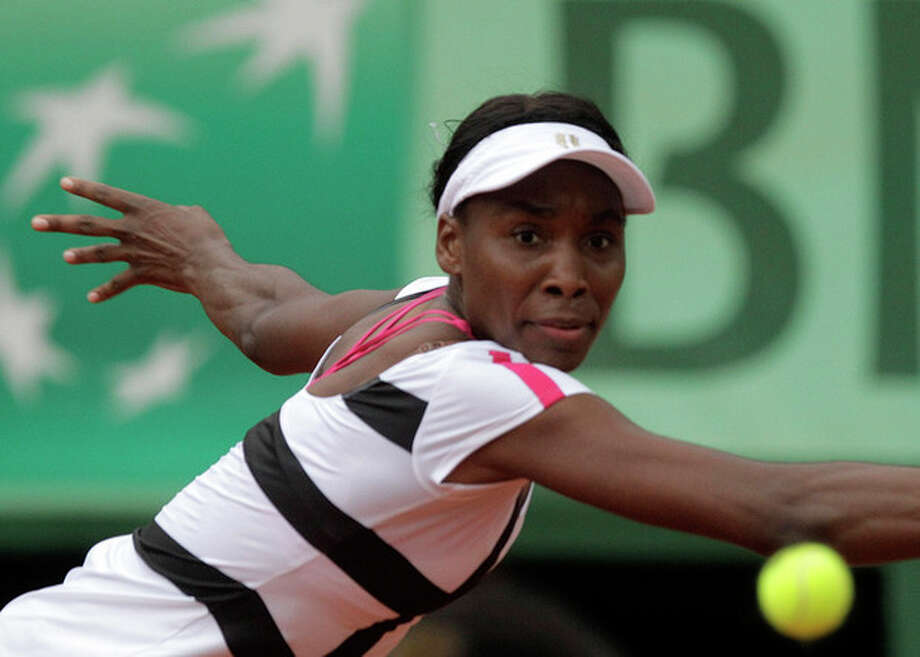 USA's Venus Williams returns the ball to Poland's Agnieszka Radwanska during their second round match in the French Open tennis tournament at the Roland Garros stadium in Paris, Wednesday, May 30, 2012. (AP Photo/Michel Spingler) / AP 2012