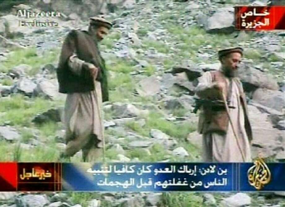 FILE - Al-Qaida leader Osama bin Laden, left, and his deputy Ayman al-Zawahri, are seen in this undated video tape relesed Wednesday, Sept. 10, 2003. For a man on the run, Osama bin laden seemed to do very little running. Instead, he chose to spend long stretches _ possibly years _ in one place and often in the company of his family. (AP Photo/Al Jazeera via APTN, File)