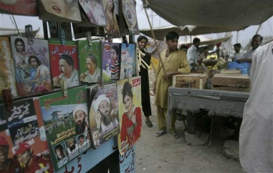 Magazines featuring on the covers former al-Qaida leader Osama bin Laden are displayed for sale along with other magazines in a market on the outskirts of Islamabad, Pakistan, Thursday, May, 12, 2011. Pakistan''s opposition leader Nawaz Sharif called for the judiciary to investigate the events surrounding bin Laden''s death, rather than the army, but it''s unclear if his proposal will gain any traction. (AP Photo/Nathalie Bardou)