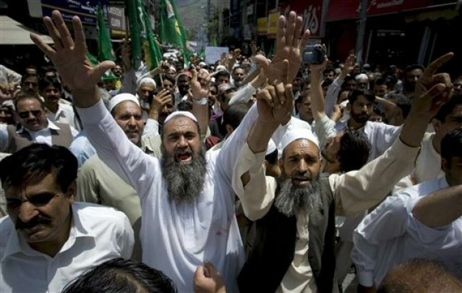 Supporters of a Pakistani opposition group Pakistan Muslim League-N party chant slogan during an anti U.S. rally in Abbottabad, Pakistan on Thursday, May 12, 2011. Pakistan''s opposition leader Nawaz Sharif called for the judiciary to investigate the events surrounding bin Laden''s death, rather than the army, but it''s unclear if his proposal will gain any traction. (AP Photo/Anjum Naveed)
