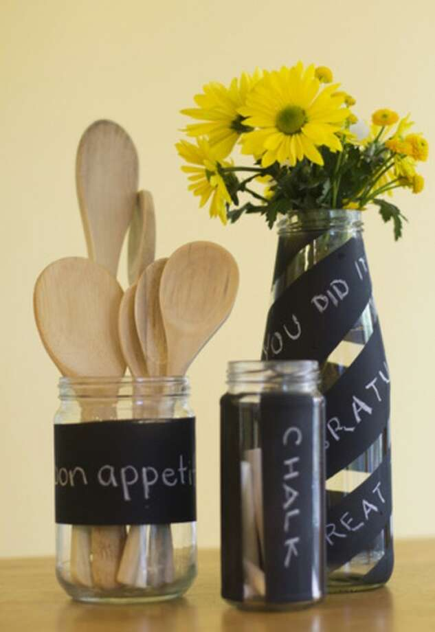 AP photoThis photo shows recycled jars and bottles decorated with chalkboard spray paint.