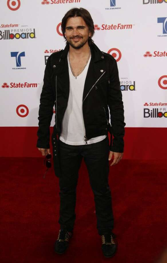 "FILE - In this April 26, 2012 file photo, Colombian singer Juanes walks the red carpet at the Latin Billboard Awards in Coral Gables, Fla. Juanes says singer-songwriter-producer Juan Luis Guerra got him out of his comfort zone when the famed musician started rearranging his songs for his ""MTV Unplugged"" taping. The singer said the 14 songs on ""Juanes: MTV Unplugged,"" released this week, is a blend of Latin, jazz, blues, rock, folk and classic sounds. (AP Photo/Wilfredo Lee, file)"