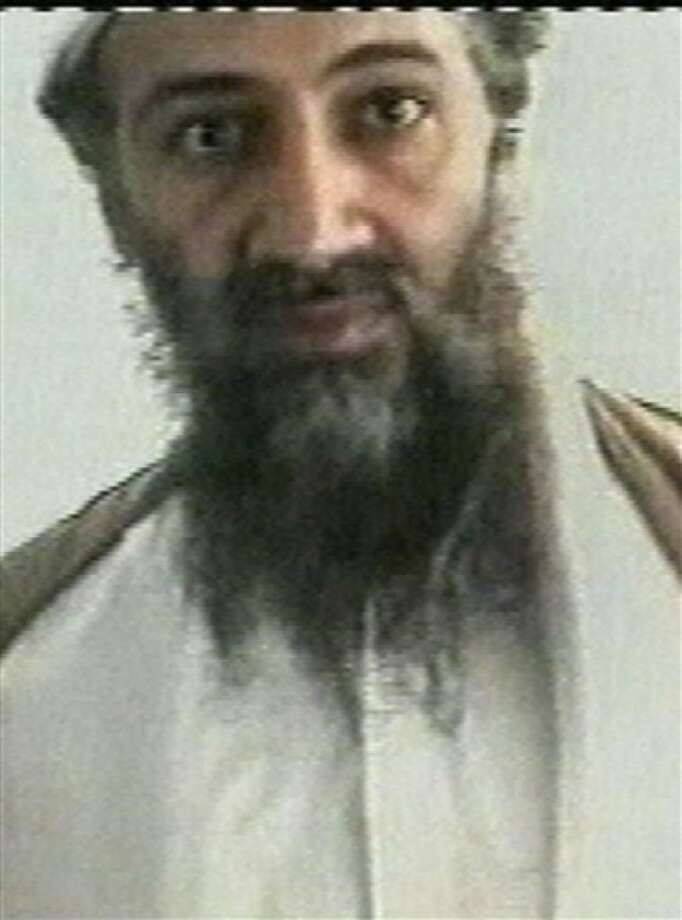 This image taken from video released by Qatar''s Al-Jazeera televison broadcast on Friday, Oct. 5, 2001, is said to show Osama bin Laden. Despite having no Internet access in his hideout, Osama bin Laden was a prolific email writer who built a painstaking system that kept him one step ahead of the U.S. government
