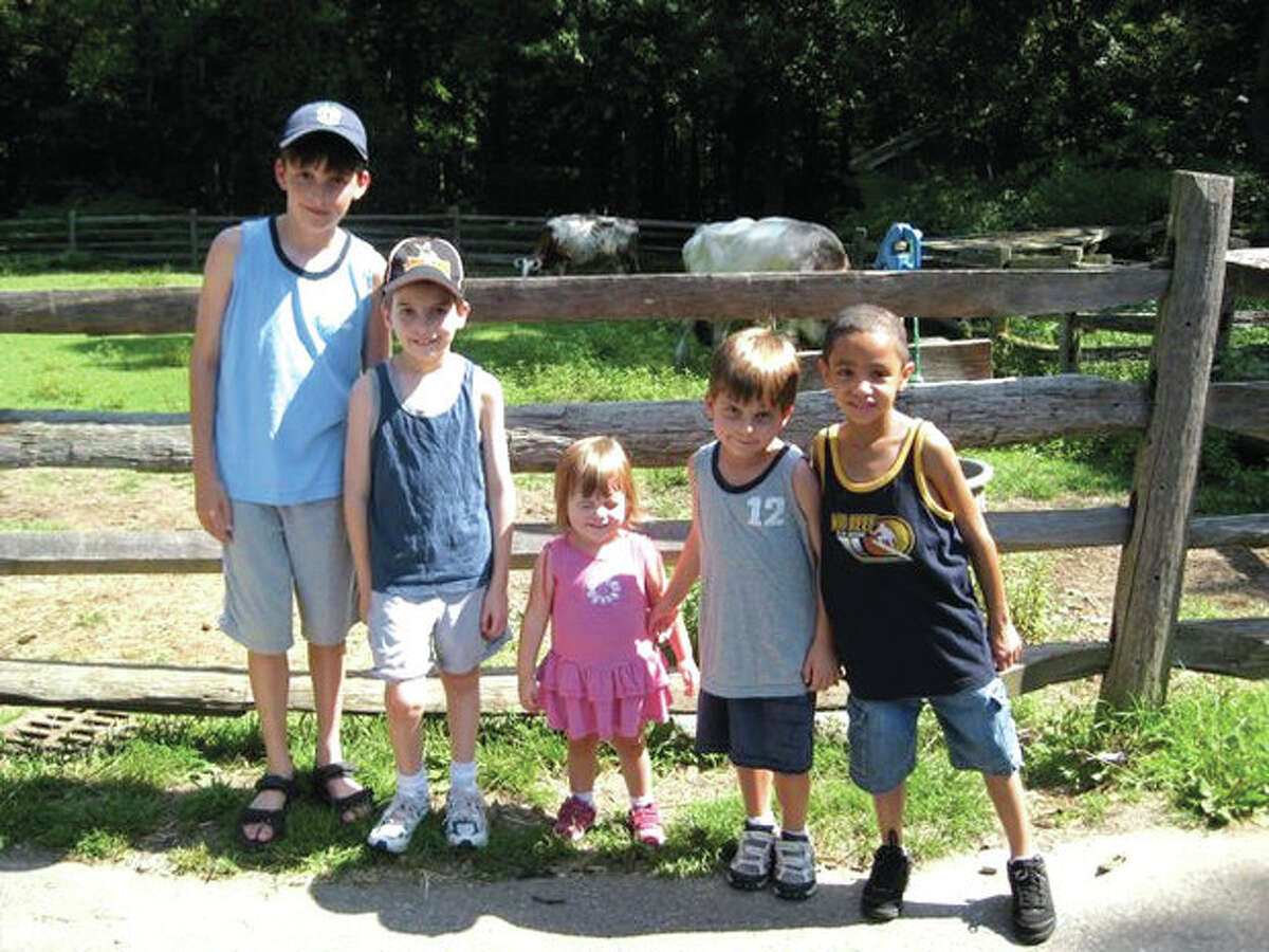 Contributed photo Members of the Allan family with Ruben, right, who, for the past four years, has been visiting the Stamford family as part of the Fresh Air Fund's host family program.