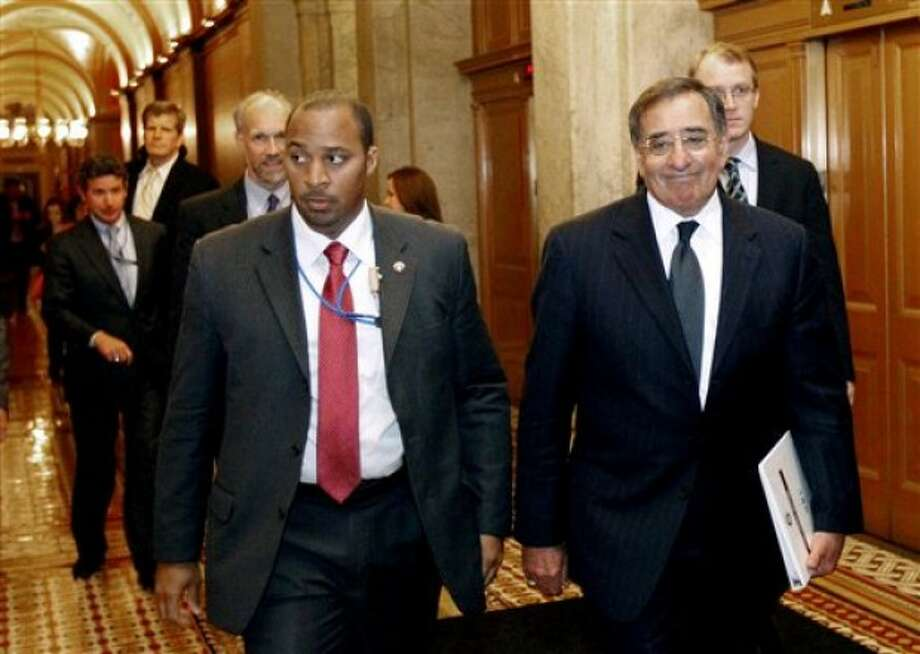 FILE - In this May 3, 2011 file photo, CIA Director Leon Panetta, right, leaves after briefing members of Congress on Capitol Hill in Washington. Some members of Congress are making appointments at CIA headquarters to view graphic photos of Osama bin Laden''s corpse. But the American people might have to wait decades to see images of the al-Qaida leader who was killed in Pakistan by Navy SEALs during a daring middle-of-the-night raid. The CIA is allowing members of the House and Senate Intelligence and Armed Services committees to see the photos in a secure room at the agency''s headquarters in Langley, Va., a CIA spokeswoman said Wednesday. Lawmakers cannot take copies of the photos with them. (AP Photo/Alex Brandon, File)