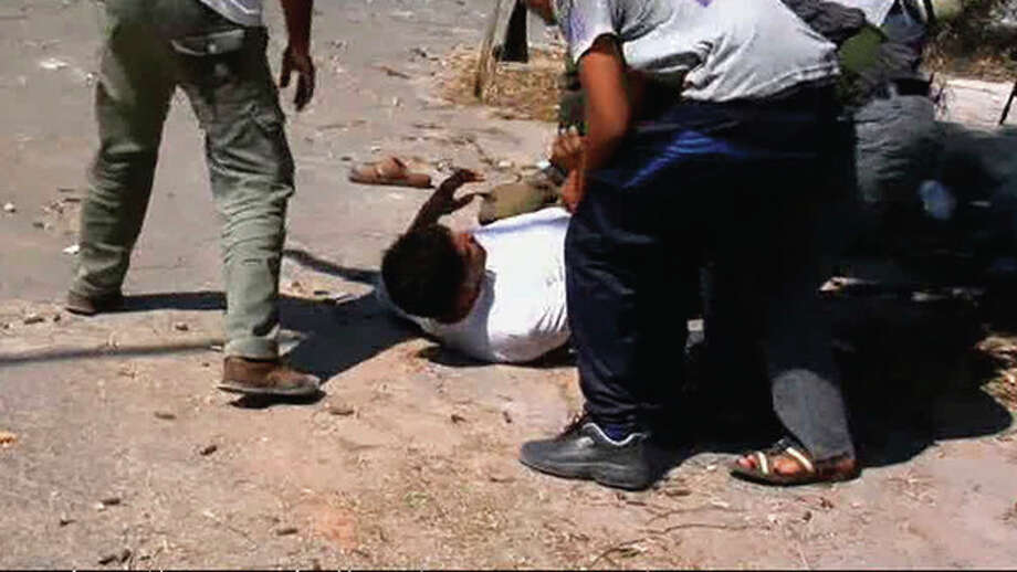 In this image from video a rebel fighter lies wounded on a street in Zawiya, Libya Friday Aug.19 2011 as they battled for control of the strategic central square against forces loyal to Moammar Gadhafi. Rebel forces were reported to have expelled government forces from Zawiya, a coastal city just 30 miles (50 kilometers) west of Tripoli, on Saturday Aug. 20. They also claim to have captured two more towns - Zlitan in the west and Brega in the east. The momentum in the six-month-old Libyan civil war now appears to have firmly swung in the rebels favor after months of near deadlock. (AP Photo/Sky via APTN) / Sky via APTN