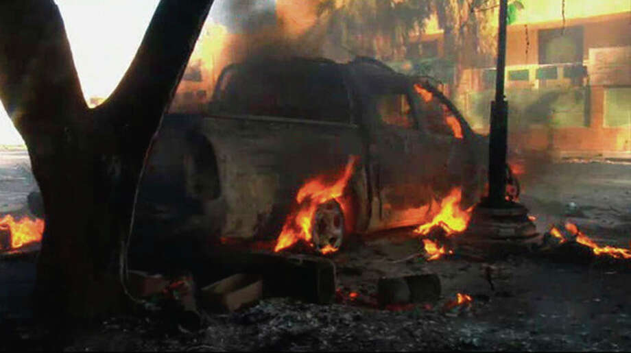 In this image from video a vehicle burns on a street in Zawiya, Libya Friday Aug.19 2011 as rebels battled for control of the strategic central square against forces loyal to Moammar Gadhafi. Rebel forces were reported to have expelled government forces from Zawiya, a coastal city just 30 miles (50 kilometers) west of Tripoli, on Saturday Aug. 20. They also claim to have captured two more towns - Zlitan in the west and Brega in the east. The momentum in the six-month-old Libyan civil war now appears to have firmly swung in the rebels favor after months of near deadlock. (AP Photo/Sky via APTN) / Sky via APTN