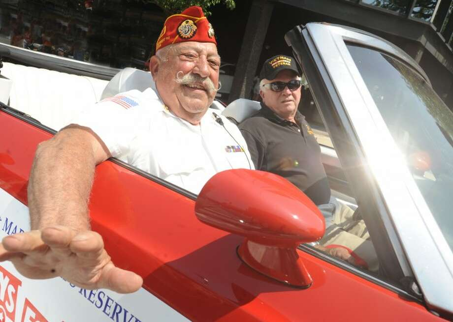 Pat Battinelli, Chairman of Patriotic & Special Events rides with Christopher Munger, special assistant to the Mayor Sunday at the Memorial Day Parade. hour photo/Matthew Vinci