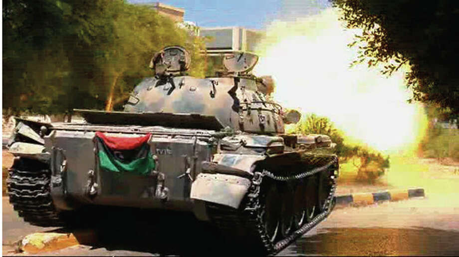In this image from video a captured tank bearing a rebel flag fires on a street in Zawiya, Libya Friday Aug.19 2011 as they battled for control of the strategic central square against forces loyal to Moammar Gadhafi. Rebel forces were reported to have expelled government forces from Zawiya, a coastal city just 30 miles (50 kilometers) west of Tripoli, on Saturday Aug. 20. They also claim to have captured two more towns - Zlitan in the west and Brega in the east. The momentum in the six-month-old Libyan civil war now appears to have firmly swung in the rebels favor after months of near deadlock. (AP Photo/Sky via APTN) / Sky via APTN