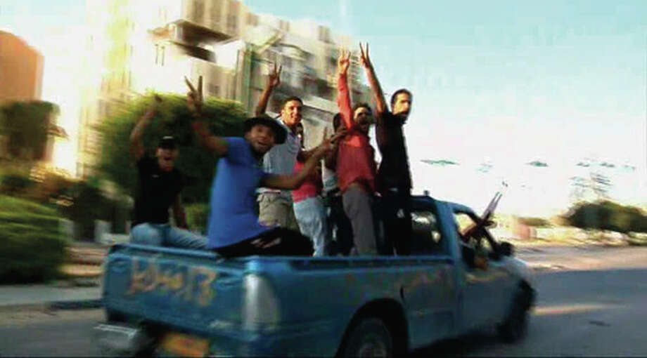 In this image from video rebel fighters celebrate victory atop a truck on a street in Zawiya, Libya Friday Aug.19 2011 after they battled for control of the strategic central square against forces loyal to Moammar Gadhafi. Rebel forces were reported to have expelled government forces from Zawiya, a coastal city just 30 miles (50 kilometers) west of Tripoli, on Saturday Aug. 20. They also claim to have captured two more towns - Zlitan in the west and Brega in the east. The momentum in the six-month-old Libyan civil war now appears to have firmly swung in the rebels favor after months of near deadlock. (AP Photo/Sky via APTN) / Sky via APTN