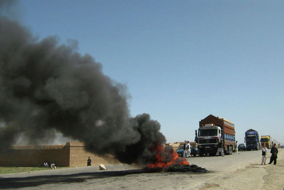 Burning tires block a highway between Kabul and Kandahar in Seed Abad, Wardak province, Afghanistan, Saturday, May 26, 2012. More then 1500 Afghan protesters demanded a stop to military night operations. (AP Photo/Rahmatullah Nikzad) / AP