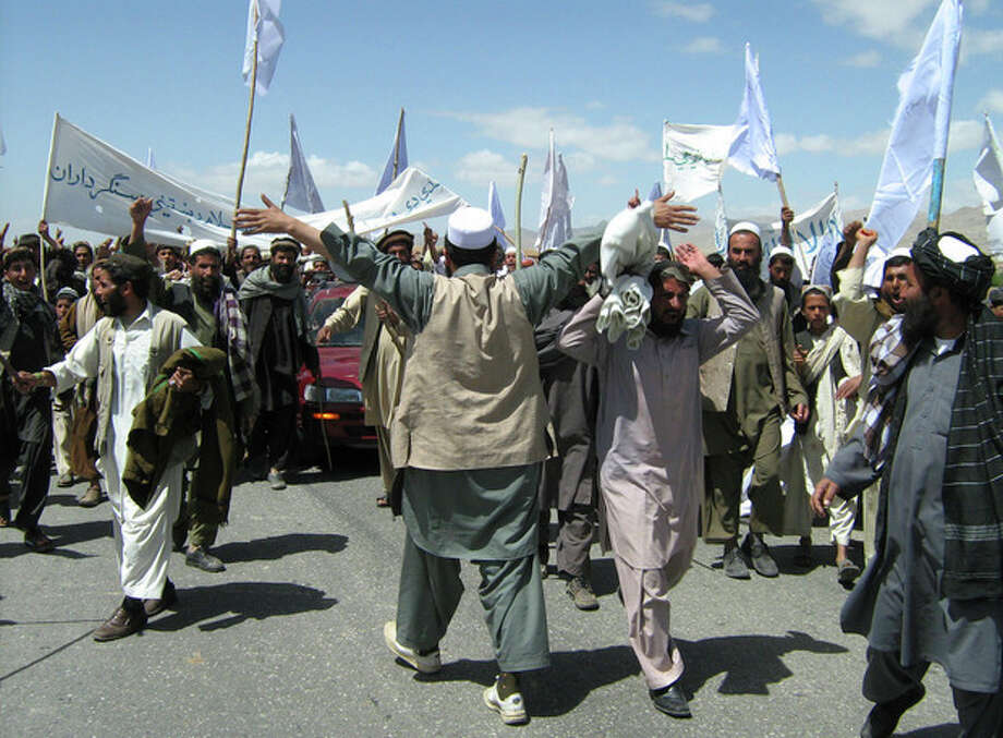More than 1,500 Afghans block the highway between Kabul and Kandahar in Seed Abad, Wardak province, Afghanistan, Saturday, May 26, 2012. The protesters demanded a stop to military night operations. (AP Photo/Rahmatullah Nikzad) / Copyright 2012 The Associated Press. All rights reserved. This material may not be published, broadcast, rewritten or redistributed.