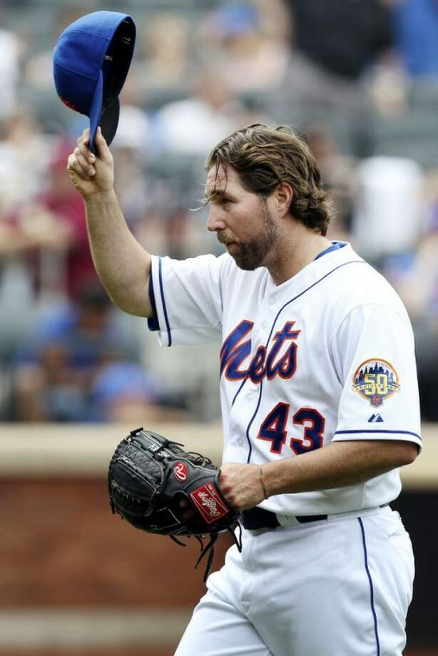New York Mets starting pitcher R.A. Dickey acknowledges the crowd as he exits during the eighth inning of a baseball game against the San Diego Padres, Sunday, May 27, 2012, at Citi Field in New York. (AP Photo/Seth Wenig).