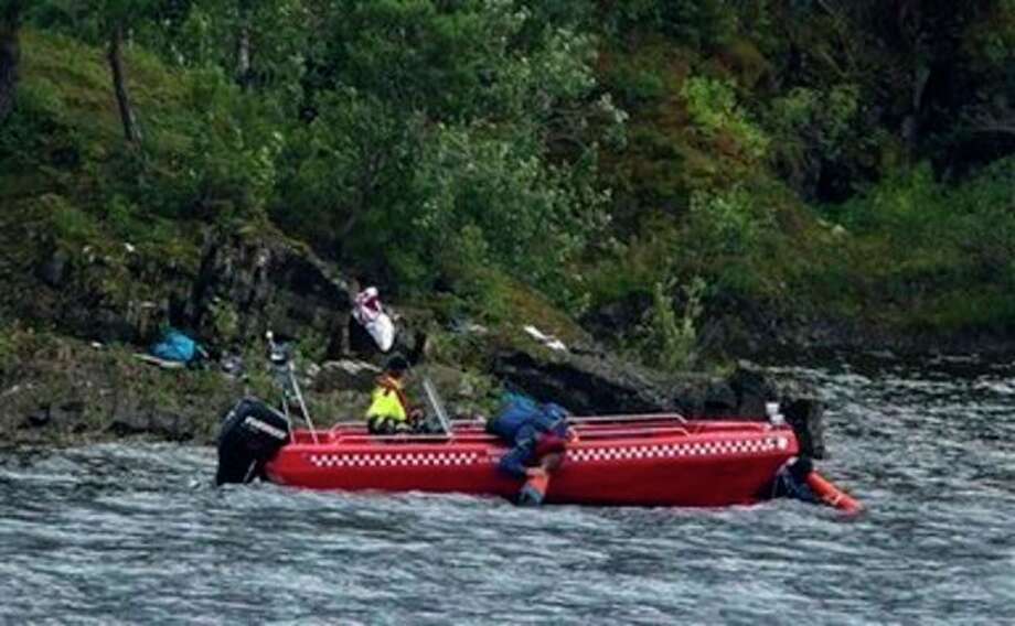 Emergency workers search for bodies beneath the water off the island of Utoya, Saturday, July 23, 2011. A Norwegian dressed as a police officer gunned down at least 84 people at an island youth retreat before being arrested, police said Saturday. Investigators are still searching the surrounding waters, where people fled the attack, which followed an explosion in nearby Oslo that killed seven. The mass shootings are among the worst in history. With the blast outside the prime minister's office, they formed the deadliest day of terror in Western Europe since the 2004 Madrid train bombings killed 191. (AP Photo/Matt Dunham) / AP