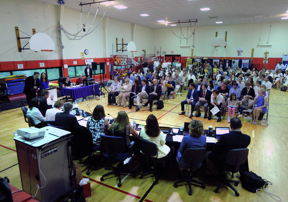 It was a full house for the final Greenwich Board of Education meeting of the school year that was held in the New Lebanon School gym in the Byram section of Greenwich on Tuesday night. , June 14, 2016. Photo: Bob Luckey Jr. / Hearst Connecticut Media / Greenwich Time