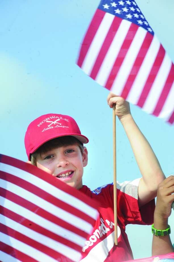 Alistair Morin 8, with the Norwalk Little League rides a float Monday at the Norwalk Memorial Day Parade. hour photo/Matthew Vinci