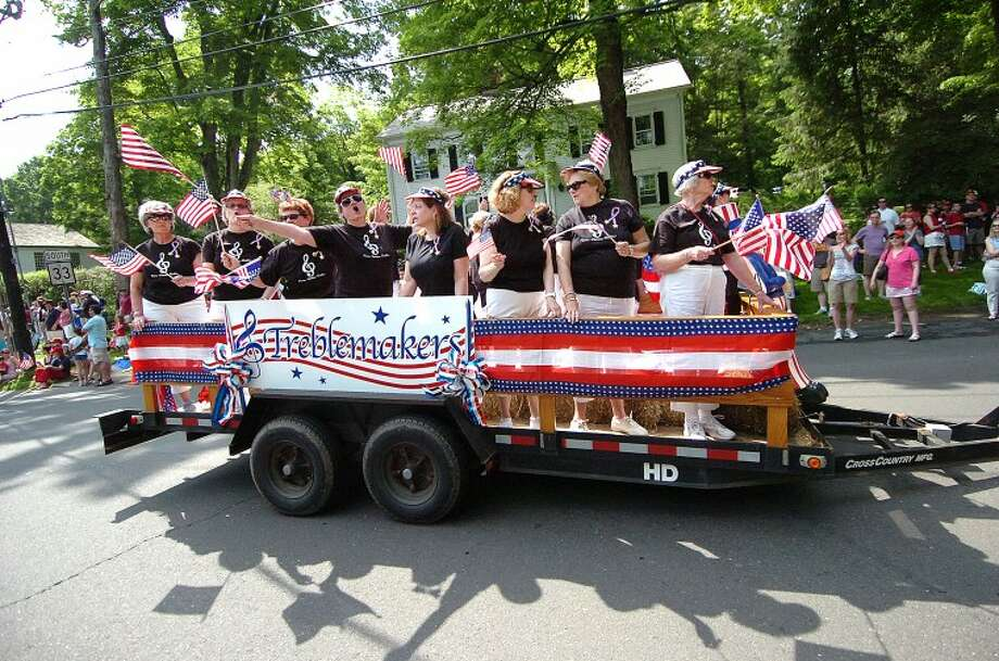 Hour Photo/ Alex von Kleydorff. The Trebblemakers sing their way down Ridgefield rd in the Memorial Day Parade.