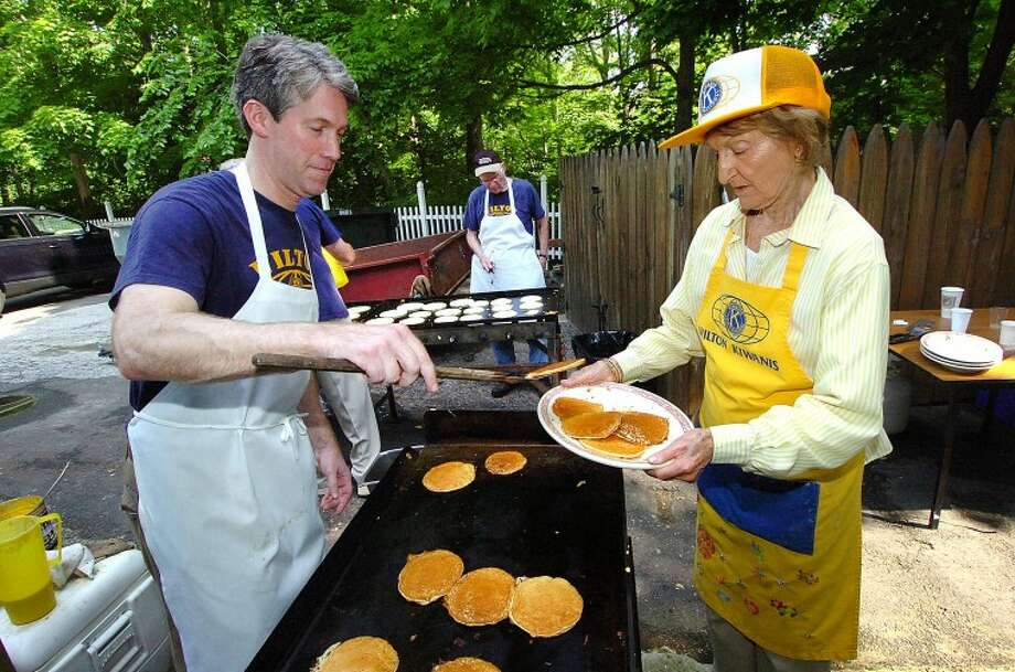 Hour Photo/ Alex von Kleydorff. Kiwanis members Tierney O'Hearn and Lois Alcosser keep the pancakes coming at the Congregational Church for the Kiwanis Pancake Breakfast.