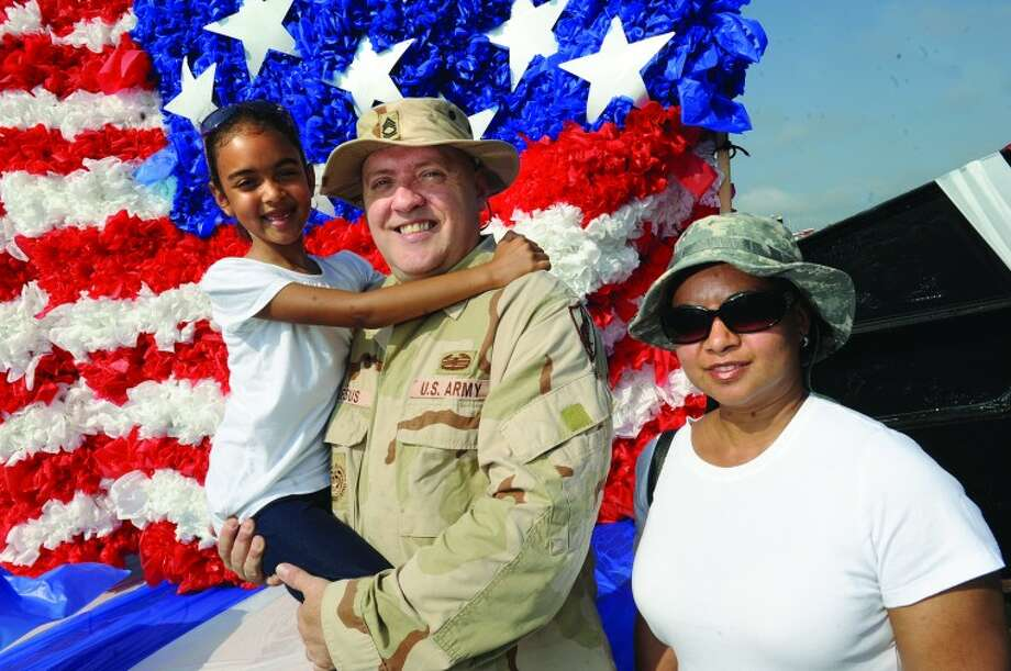 Army veteran David DeJesus with his daughter Anais 8, and wife Mariana at the Norwalk Memorial Day Parade. hour photo/Matthew Vinci