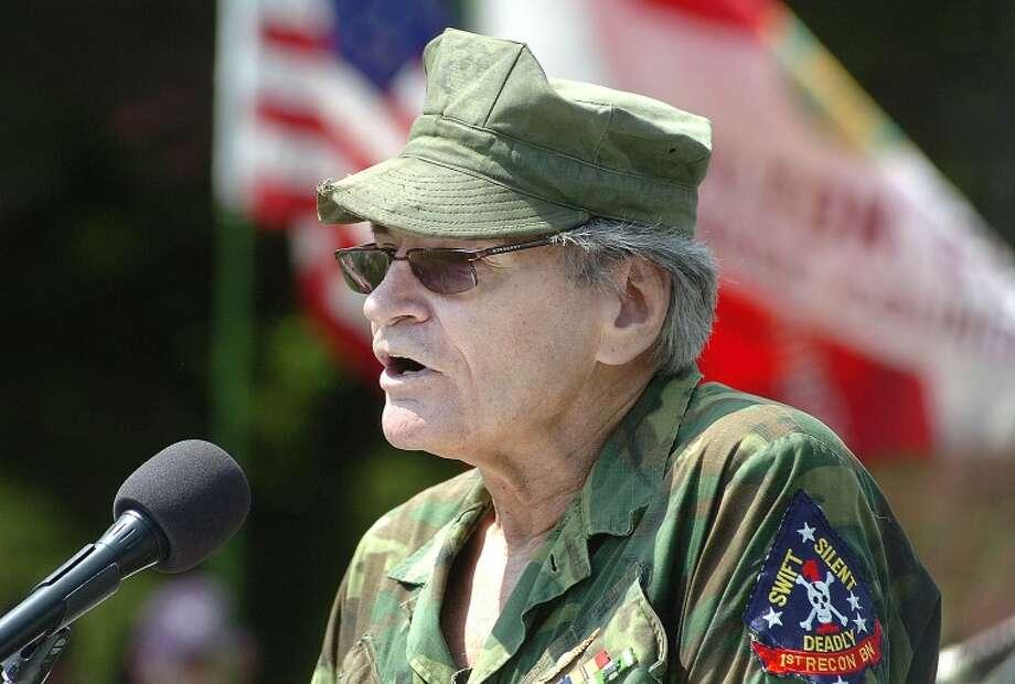 Hour Photo/ Alex von Kleydorff. Keynote Speaker Dennis Sutton talks about his service with the Marines Recon unit in Vietnam