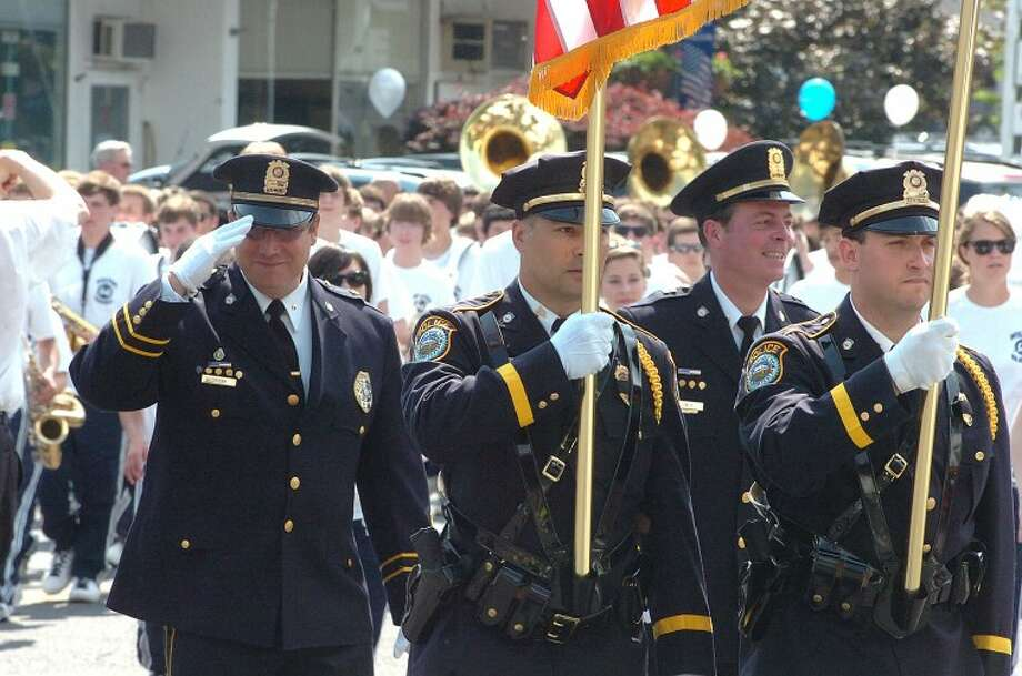 Hour Photo/ Alex von Kleydorff. Wilton Police march in the Wilton Memorial Day parade.