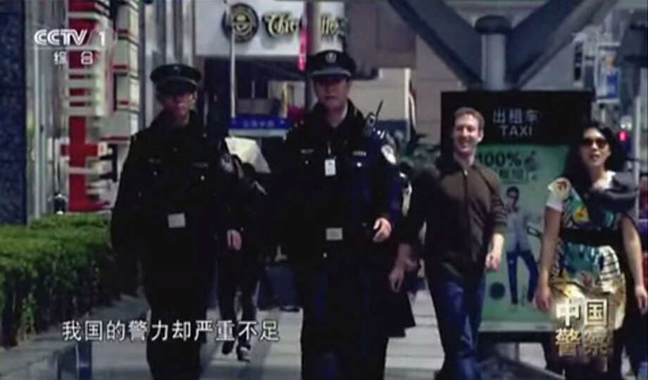 AP Photo/CCTVIn this image taken from undated CCTV video, Facebook founder Mark Zuckerberg and his now-wife, Priscilla Chan, appear in a Chinese TV documentary about the country's police force. / CCTV