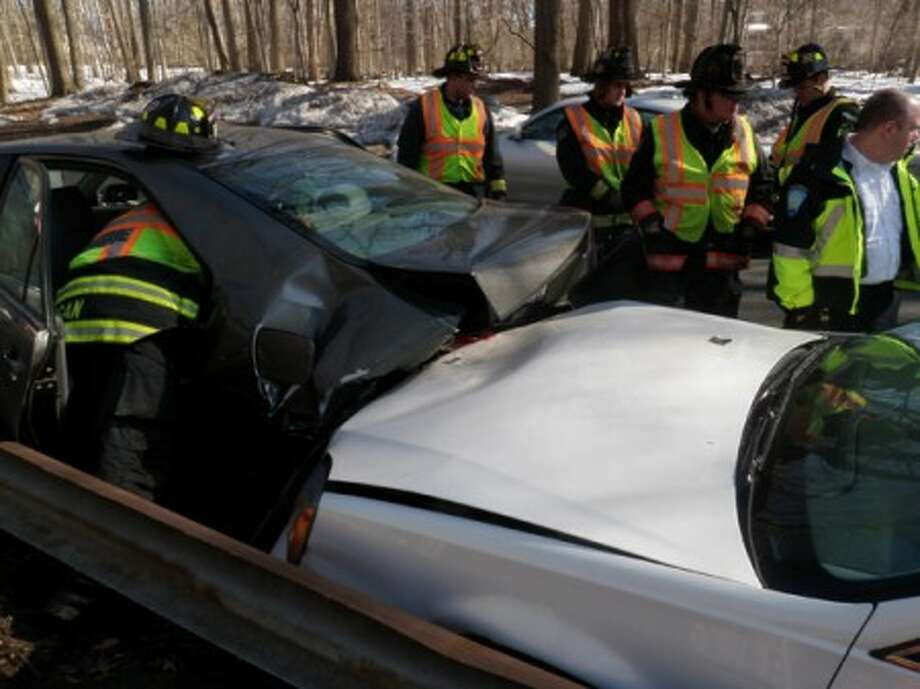 The Westport Fire Department responds to a Merritt Parkway crash.