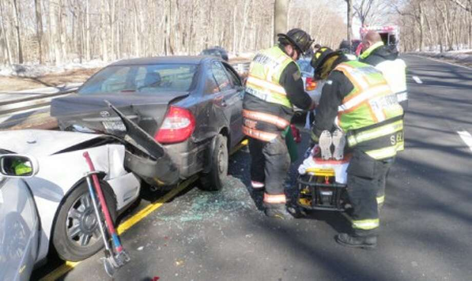 Westport Fire Department helps a vicitim of a Sunday afternoon crash.