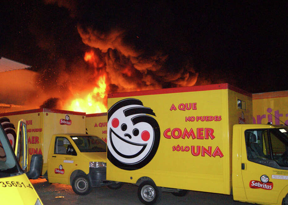 AP PhotoIn this photo taken late Friday, May 25, 2012, flames rise from a warehouse of the Mexican potato-chip company Sabritas, in Lazaro Cardenas, Mexico. / AP