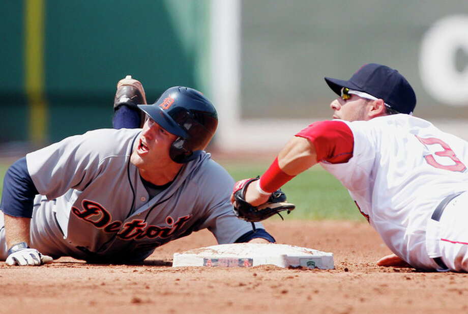Detroit Tigers' Danny Worth, left, and Boston Red Sox's Mike Aviles look up as Worth is called out at second base after trying to reach on a single in the third inning of a baseball game in Boston, Monday, May 28, 2012. (AP Photo/Michael Dwyer) / AP