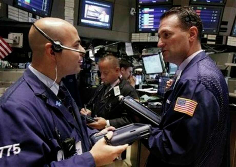 In this photo take Aug. 24, 2011, traders Fred Demarco, left, and Jonathan Corpina, right, work on the floor of the New York Stock Exchange. World stock markets rose Thursday, Aug. 25, 2011, as worries eased that the U.S. might be slipping toward recession, while the resignation of Steve Jobs _ the creative force behind Apple Inc. _ sent ripples through the technology sector.( AP Photo/Richard Drew) / AP
