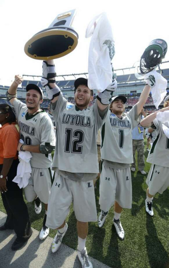 Loyola lacrosse players Eric Lusby (12), T.J. Harris, left, and Michael Bonitatibus (1) celebrate their 9-3 victory over Maryland in the Division I NCAA men's lacrosse championship game at Gillette Stadium in Foxborough, Mass., Monday, May 28, 2012. (AP Photo/Gretchen Ertl)