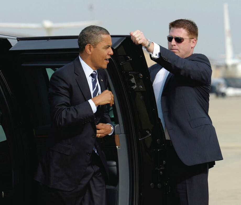 President Barack Obama gets out of his car before boarding Air Force One at Andrews Air Force Base in Md., Tuesday, Oct. 11, 2011, on his way to visit the International Brotherhood of Electrical Workers (IBEW) Local No. 5 Training Center. (AP Photo/Susan Walsh) / AP
