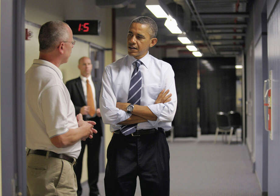 President Barack Obama talks with electrical apprenticeship instructor Tim Wisyanski during a visit to the International Brotherhood of Electrical Workers (IBEW) Local No. 5 Training Center in Pittsburgh, Tuesday, Oct. 11, 2011. (AP Photo/Susan Walsh) / AP