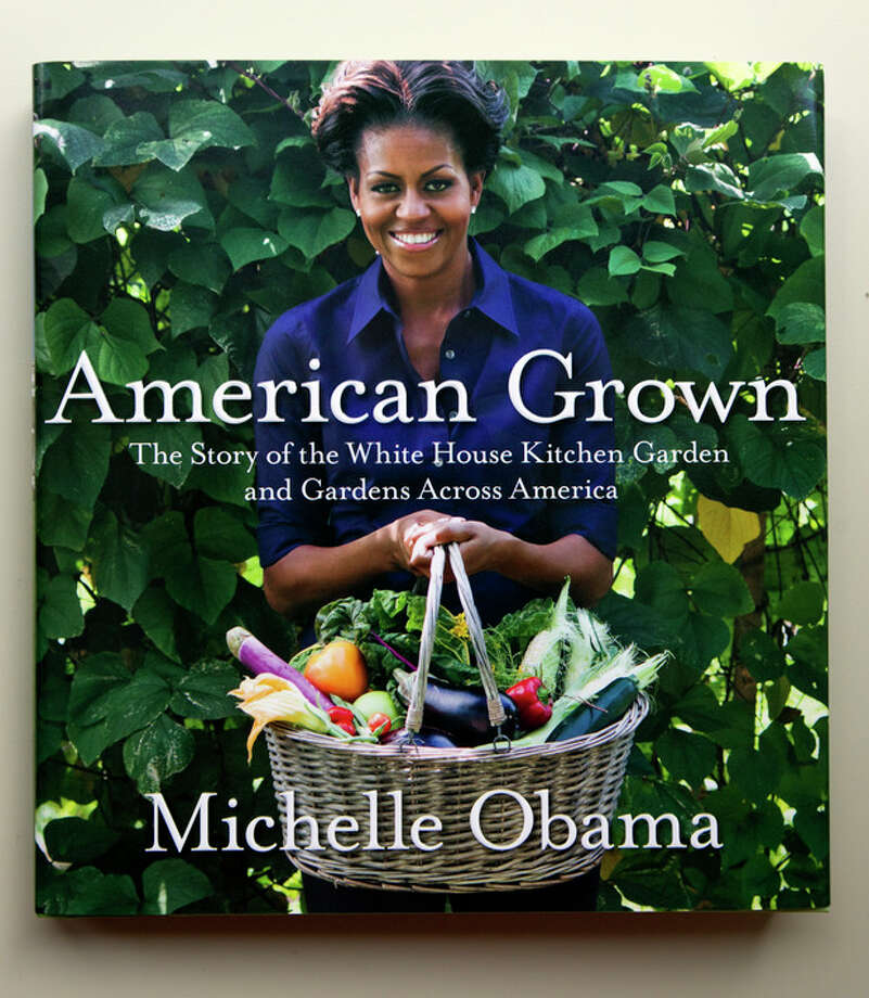 HOLD FOR RELEASE AT 12:01 A.M. TUESDAY, MAY 29, 2012, AND THEREAFTER WITH STORY SLUGGED: MICHELLE OBAMA BOOK - A copy of first lady Michelle Obama's book is seen in Washington, Thursday, May 24, 2012. From the beginning, Obama's kitchen garden has been an overachiever, churning out more peppers, parsley and eggplant than expected, and generating interest that _ yes, really _ crosses oceans. (AP Photo) / AP