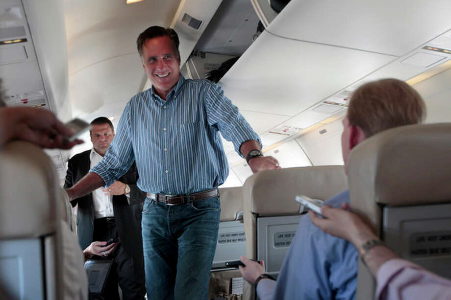 Republican presidential candidate, former Massachusetts Gov. Mitt Romney, speaks to reporters on board the campaign charter airplane, Monday, May 28, 2012, in San Diego. (AP Photo/Mary Altaffer) / AP