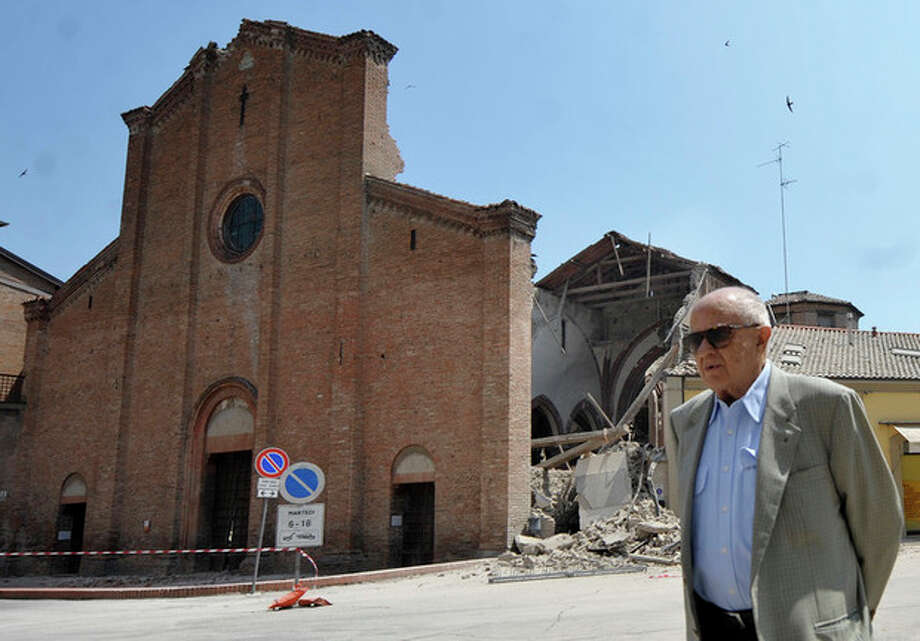A man walks in front of a collapsed church in Mirandola, northern Italy, Tuesday, May 29, 2012. A magnitude 5.8 earthquake struck the same area of northern Italy stricken by another fatal tremor on May 20. (AP Photo/Marco Vasini) / AP