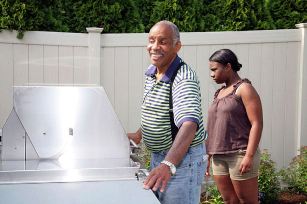 Richard Fuller shows off the Grill he won as part of the back yard makeover he won from Gault for Father's Day.