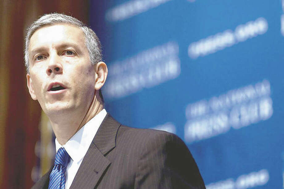 "Education Secretary Arne Duncan speaks about the federal ""Race to the Top"" school reform grant competition, Tuesday, July 27, 2010, at the National Press Club in Washington. (AP Photo/Drew Angerer) / AP"