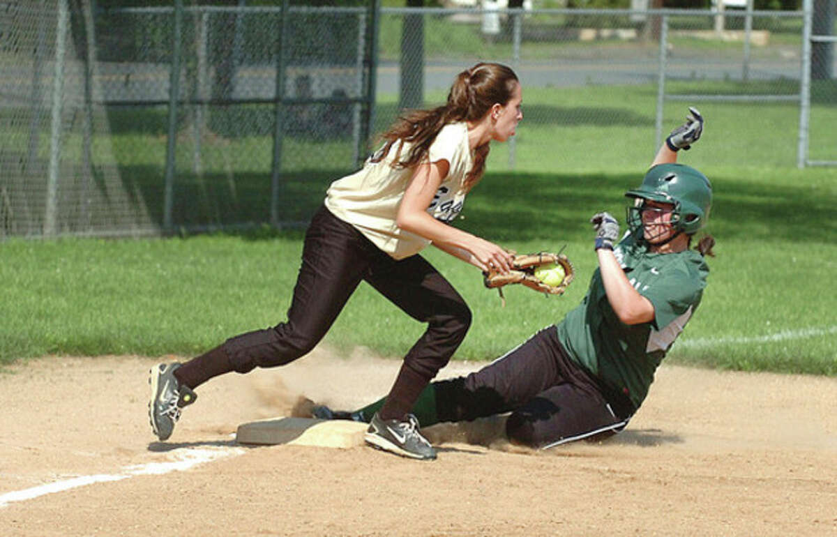 Hour photo/Alex von Kleydorff Norwalk's Aly Brown slides safely into third base ahead of the tag by Alexandria Passero of Trumbull during Tuesday's Class LL state tournament game in Norwalk. The Bears claimed a 7-4 victory.