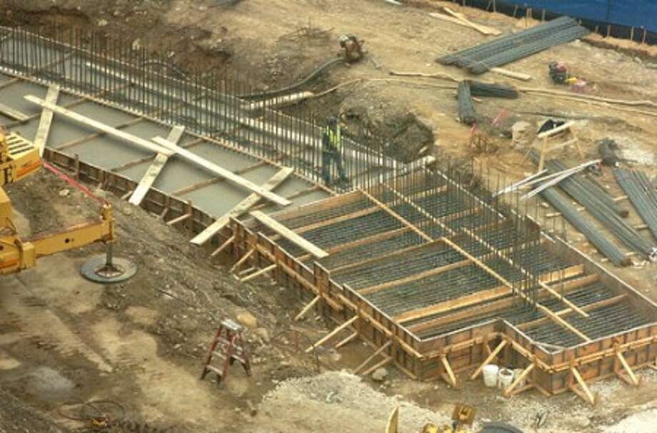 Photo/Alex von Kleydorff. Foundation is poured for a new retaining wall at the Norwalk Hospital garage construction site.