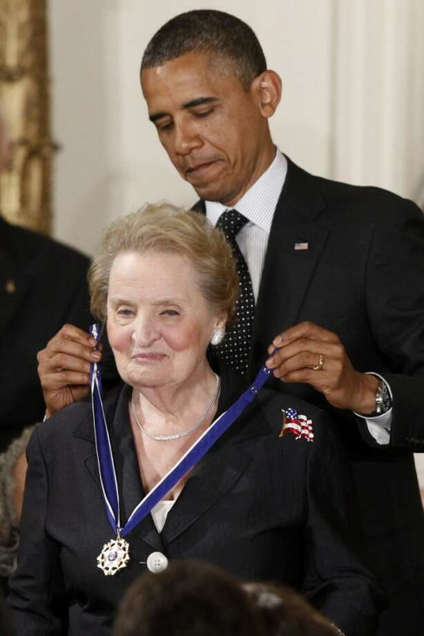 President Barack Obama awards the Medal of Freedom to former Secretary of State Madeleine Albright during a ceremony in the East Room of the White House in Washington, Tuesday, May 29, 2012. The Medal of Freedom is the nation's highest civilian honor. It's presented to individuals who have made especially meritorious contributions to the national interests of the United States, to world peace or to other significant endeavors. (AP Photo/Charles Dharapak)