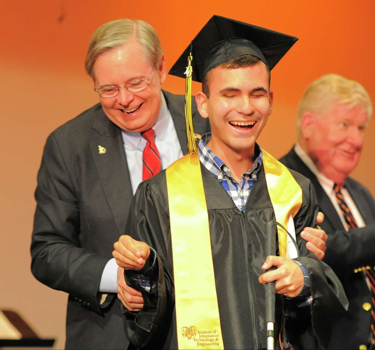 Stamford Mayor David Martin faces Brian Martin towards the audience as he makes his way across stage and is recognized with a standing ovation by his peers and audience during the Academy of Information Technology and Engineering Class of 2016 commencement at the school in Stamford, Conn., on Tuesday, June 14, 2016. Martin express it was his goal to navigate the stage unassisted when it came time to receiving his diploma.