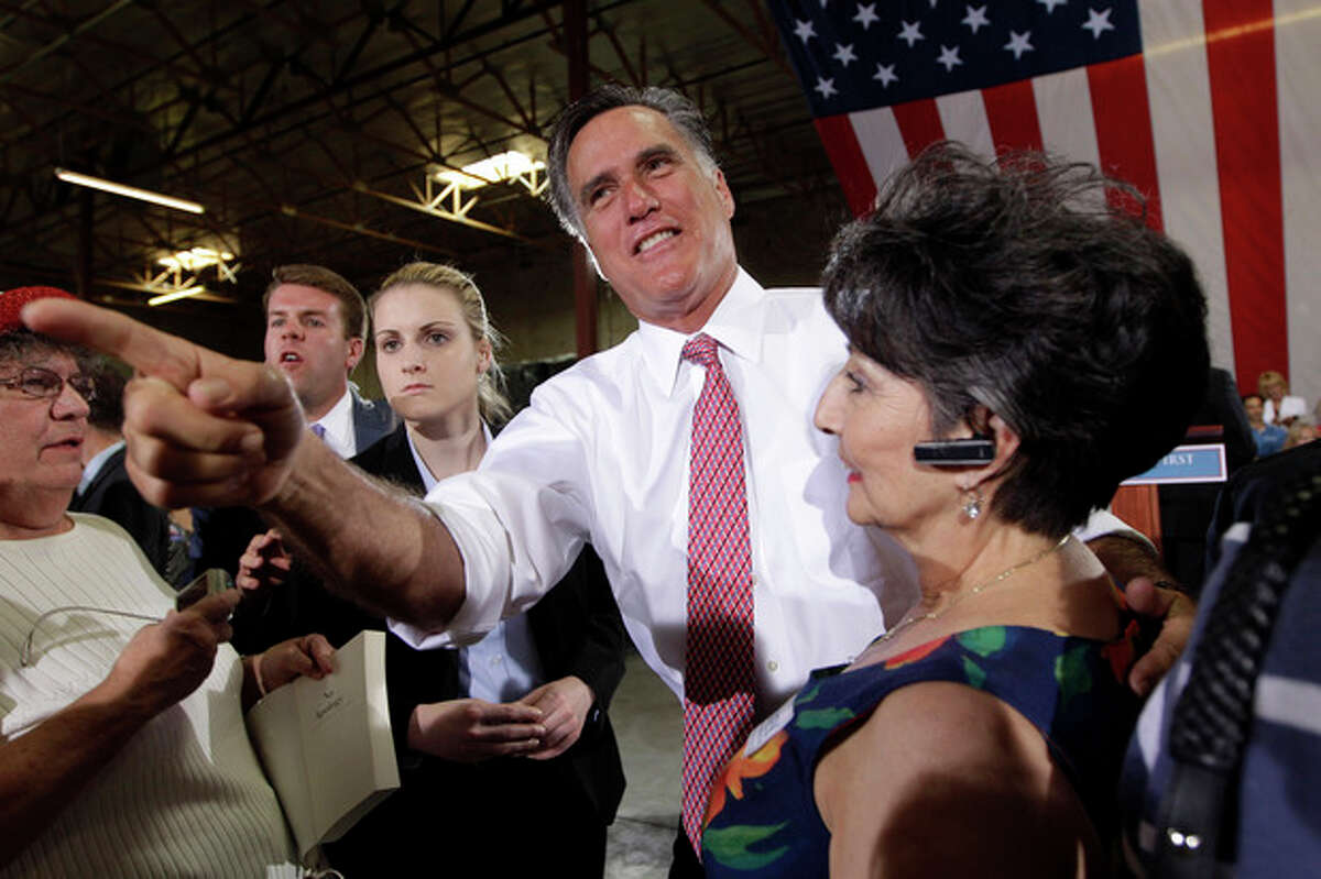 Republican presidential candidate, former Massachusetts Gov. Mitt Romney, greets supporters after speaking at a campaign event at the Somers Furniture warehouse in Las Vegas, Tuesday, May 29, 2012 in Las Vegas. (AP Photo/Mary Altaffer)