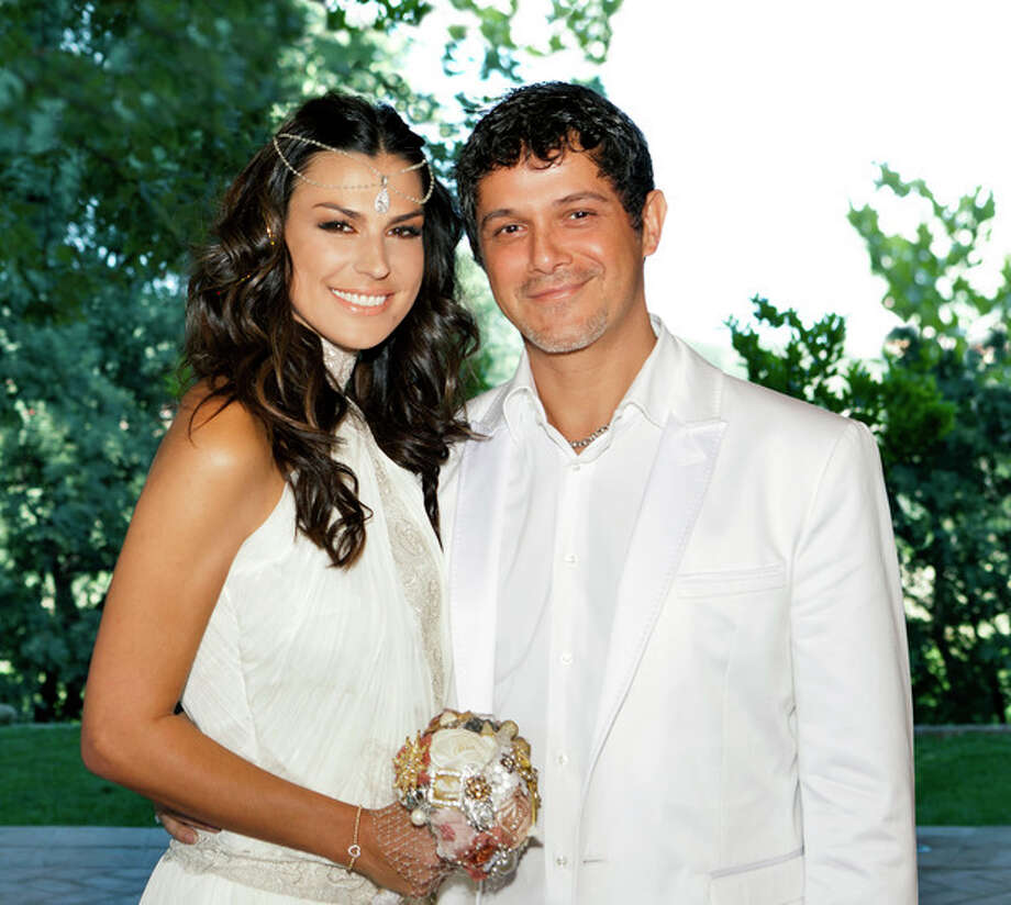 In this photo, taken Saturday, May 26, 2012 and released by Rondene Public Relations Tuesday, May 29, 2012, newlyweds Alejandro Sanz and Raquel Perera pose for a photo at an undisclosed location in Spain. The couple were married in a religious ceremony in Barcelona on Wednesday, May 23, 2012 and then renewed their vows on Saturday, coinciding with the christening of his son, Dylan. (AP Photo/Rondene Public Relations) / Rondene Public Relations