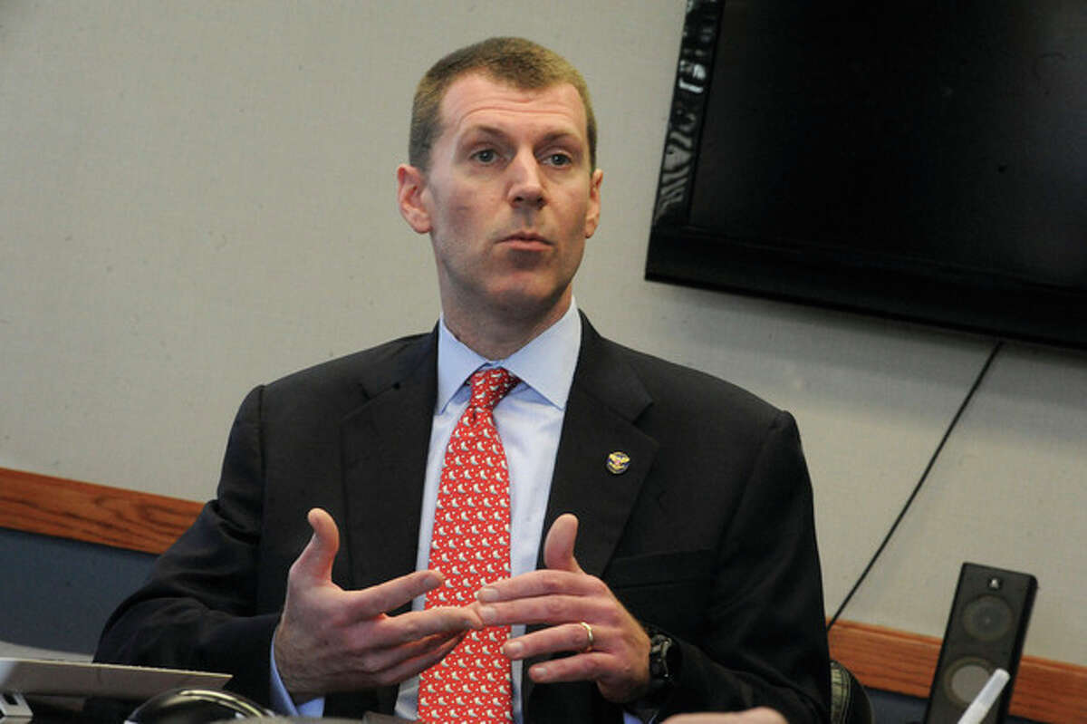 Christopher Meeks speaks to the editorial board at The Hour Newspapers in March. File photo by Matthew Vinci.